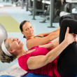 Fitness center senior womexercise gym workout — Stock Photo #9624703