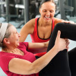 Fitness center senior woman exercise gym workout — Stock Photo #9624704