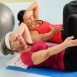 Fitness center senior woman exercise gym workout - Stock Photo
