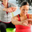 Two women at gym stretch out — Stock Photo #9624735