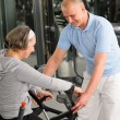 Stock Photo: Senior womwith help of physiotherapist