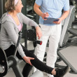 Physiotherapist assist active senior woman at gym — Stock Photo