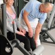 Physiotherapist assist active senior woman at gym — Photo