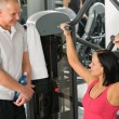 Personal trainer at fitness center show exercise — Stock Photo