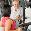 Active man watch personal trainer show exercise — Stock Photo
