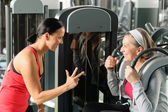 Personal fitness trainer with senior woman exercise — Stock Photo