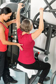 Fitness center trainer senior woman exercise back — Stock Photo