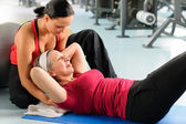 Senior woman exercise abdominal in fitness center — Stock Photo