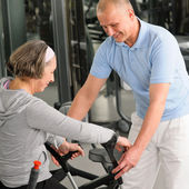 Senior woman with help of physiotherapist — Stock Photo