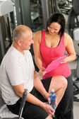 Fitness personal plan active man with trainer — Stock Photo