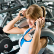 Fitness center young woman exercise abdominal — Stock Photo #9776473