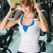 Fitness center young woman exercise abdominal — Stock Photo #9776475