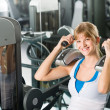 Stock Photo: Fitness center young woman exercise abdominal