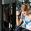 Stock Photo: Young womexercise abdominal fitness center