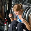 Fitness center young woman exercise abdominal — Stock Photo
