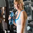 Young woman relax sit fitness machine — Stock Photo