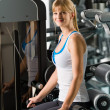 Young woman exercise at gym — Stock Photo #9776486