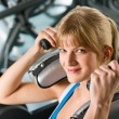 Stock Photo: Young woman at gym exercise fitness