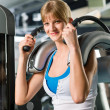 Young woman at fitness center exercise abdominal — Stock Photo