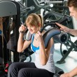 Fitness center young woman exercise with trainer — Stock Photo #9776499