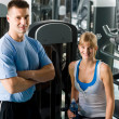 Young woman with fitness trainer - Stock Photo