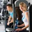 Stock Photo: Womat fitness center