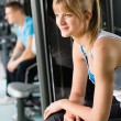 Two at fitness center exercise machine — Stock Photo #9776514