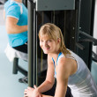 Two at fitness center exercise machine — Stock Photo