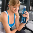 Health club young woman relax at machine — Stock Photo