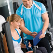 Check fitness exercise plan with personal trainer — Stock Photo