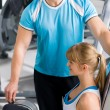 Royalty-Free Stock Photo: Personal trainer with young woman at gym