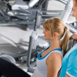 Personal trainer with young woman at gym — Stock Photo #9776530