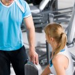 Personal trainer with young woman at gym — Stock Photo #9776531