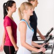 Stock Photo: Young on treadmill running exercise