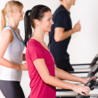 Young on treadmill running exercise — Stock Photo