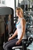 Young woman exercise at gym — Stock Photo