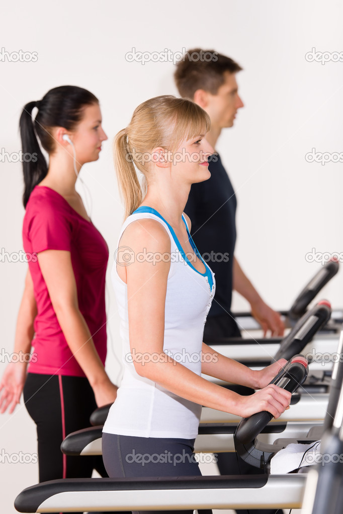 Walking on treadmill young running exercise at fitness center — Stock Photo #9776532