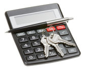 Calculator, pen and key — Stock Photo