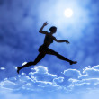 Young woman is jumping above the clouds — Stock Photo