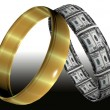 Wedding rings symbolizing prenuptial agreement - Stock Photo
