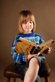 Child book chair studio — Stock Photo