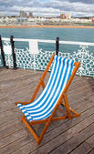 Deck chair pier sea coastline — Stock Photo