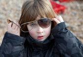 Child sunglasses broken playing — Stock Photo