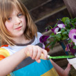 Flowers child gardening bloom — Stock Photo