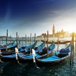Gondolas on Grand Canal and San Giorgio Maggiore church in Venic - Stock Photo
