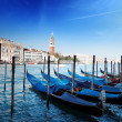 Gondolas on Grand Canal and St Marks Tower - Stock Photo