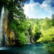 Waterfall in deep forest - Foto Stock