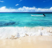 Boat and Caribbean sea — Stock Photo