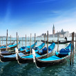 Gondolas on Grand Canal and San Giorgio Maggiore church in Venic — Stock Photo #8775165
