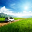 Ground road and blurred car — Stock Photo